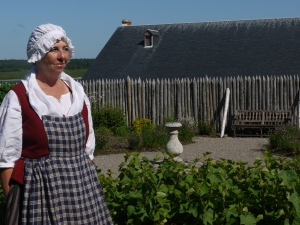 Dressed as a servant and ready to cook in the kitchen of the Engineer in Fortress Louisbourg.