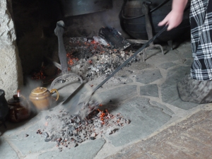 Moving coals for the dutch oven