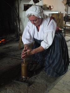 Frothing hot  chocolate over hot coals in Fortress Louisbourg.