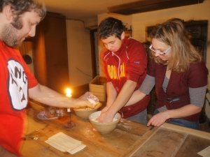 Julia and Slavo Osokin work with Fredrick Adlhoch to mix  dough for tarts