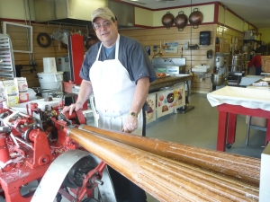 Fred Stritch works on old machinery to make handmade candy