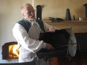 John Hammond, and expert meat roaster shows the class a Tin Kitchen