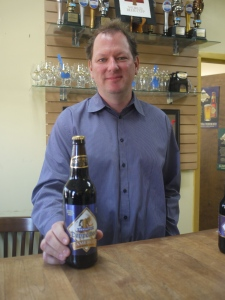 Brew Master Jason Britton with a bottle of Cameron's Doppelbock Beer