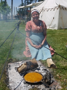 Shelley Mason, a reenactor at the Battle of Stoney Creek cooks a Sweet Potato pie for the Cast Iron Cook-Off