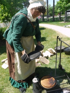 Reenactor, Sandra Burnison prepares a Parsnip Loaf for the Cast Iron Cook-Off