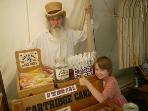 Jeff Wakefield sells candy to Jessica Peterson in his Candy Tent