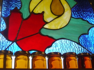 A Sugar Moon Farm window and bottles of Maple Syrup.