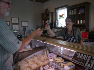 A visitor samples cheese at Pied-De-Vent.