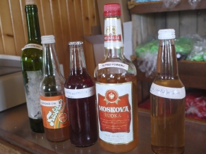 Five bottles from Leonce's collection of fifty bottles of Bagosse from different families from the Magdalen Islands.