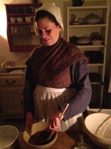 Kate Gardener mixes a gingerbread cake to cook on her cast iron stove.