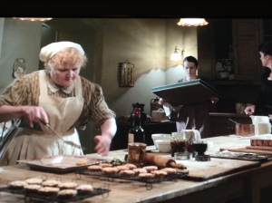 Mrs. Patmore prepares pastry in her kitchen for the Crawley family of Downton Abbey.