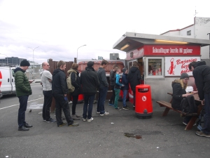 A line up at the famous Baejarins Beztu Pylsur, that has been serving Iceland hot dogs since 1937.