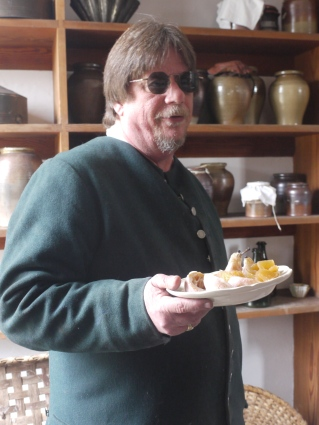 Frank Clark, Master of Historic Foodways at Williamsburg holds a plate of confections made by the skilled cooks.
