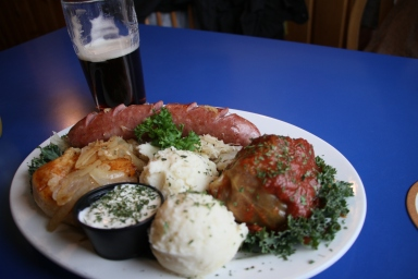 Main sampler plate, cabbage roll, polish sausage and pierogie